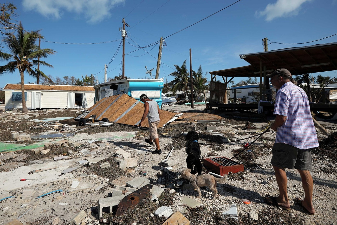 Local residents walk along a destroyed trailer park after Hurricane Irma strikes Florida, in Plantation Key in the Florida Keys, U.S., September 12, 2017. (Reuters Photo)