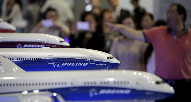 Visitors look at models of Boeing aircrafts at the Aviation Expo China 2015, in Beijing, China, in this September 16, 2015 file photo. (Reuters Photo)