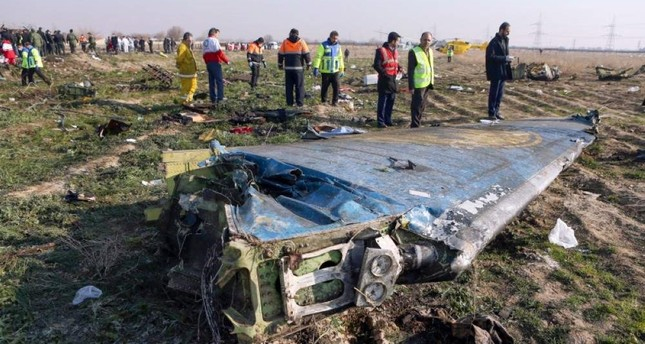This file handout photo provided by the IRNA news agency shows rescue teams work at the scene of a Ukrainian airliner that crashed shortly after takeoff near Imam Khomeini Airport in the Iranian capital Tehran, on Jan. 8, 2020. Photo by Akbar TAVAKOLI / IRNA / AFP