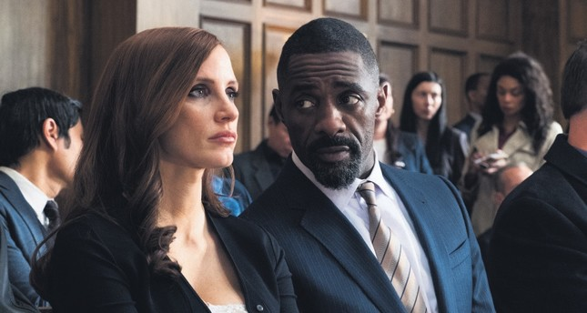 Jessica Chastain, left, and Idris Elba in a scene from Molly's Game.