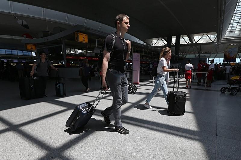 Travelers walk through International Terminal Four at John F. Kennedy International Airport in Queens, New York, USA, 30 June 2017. (EPA Photo)