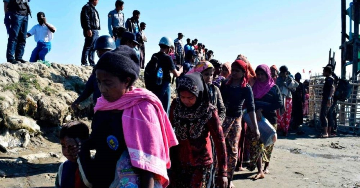 In this file photo taken on Nov. 30, 2018, Myanmar navy personnel escort Rohingya Muslims back to their camp in Sittwe, Rakhine state. (AFP Photo)