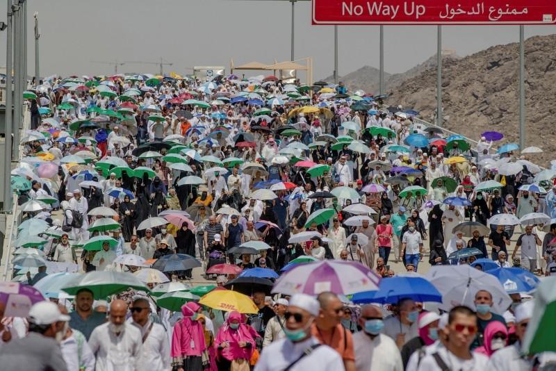 Muslim pilgrims walk towards Jamarat to cast stones at three huge stone pillars in the symbolic stoning of the devil on the last day of the annual hajj pilgrimage in Mina, outside the holy city of Mecca, Saudi Arabia, Aug. 23, 2018. (AP Photo)