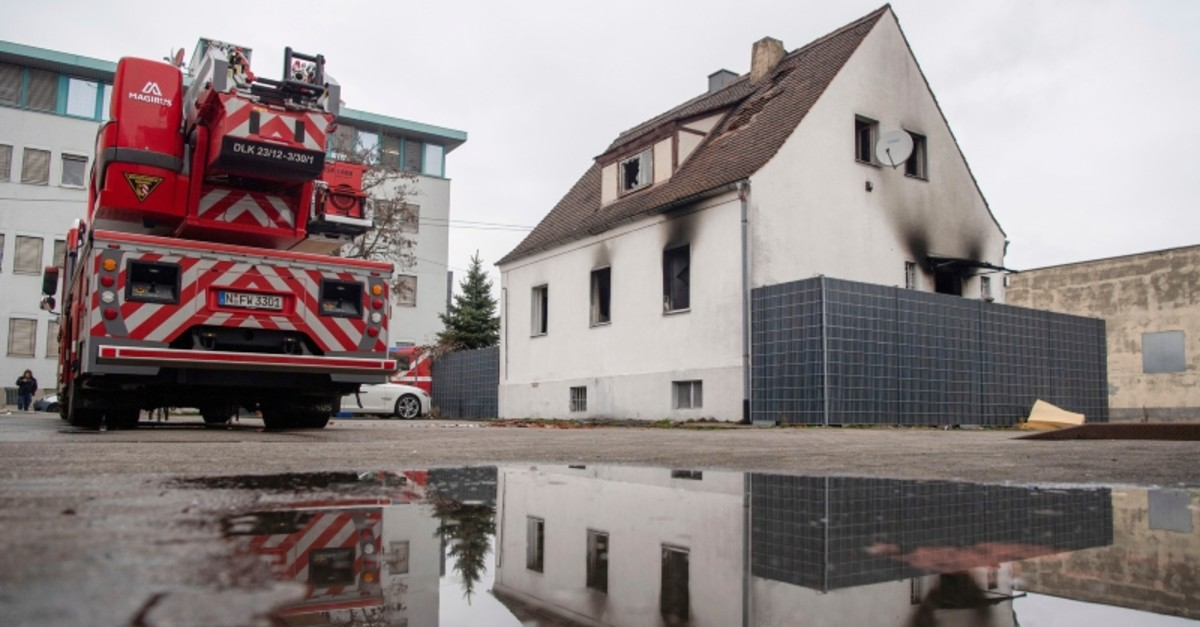 A fire truck stands in front of a house damaged by a fire in Nuremberg, Germany, March 2, 2019. Four children an a woman were killed by the fire (AP Photo)