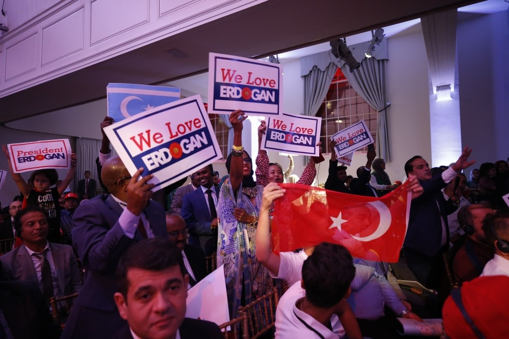 People wave flags and placards as they welcome President Erdou011fan arriving to make a speech at a meeting of the Turkish-American Steering Committee (TASC) in New York. Erdou011fan arrived in the city yesterday to participate in the U.N. General Assembly.