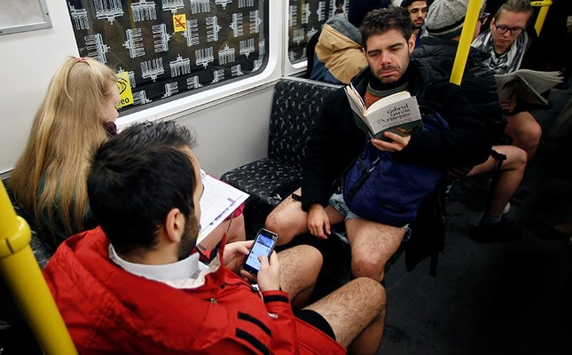 People take part in the annual 'No Pants Subway Ride' in Berlin, Germany, January 8, 2017. (Reuters Photo)