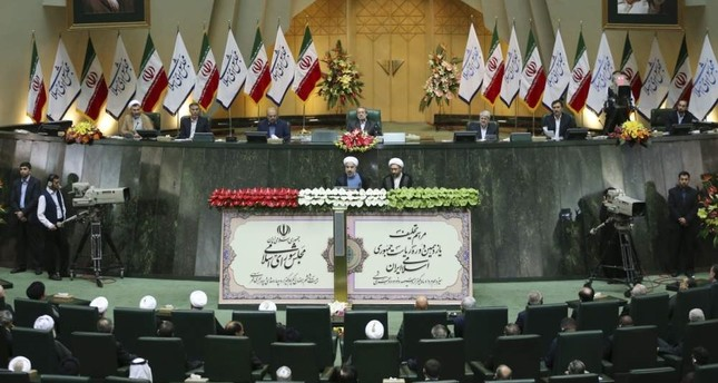Iran's President Hassan Rouhani L swears-in as he stands next to judiciary chief Sadeq Larijani R at the parliament, Tehran, Aug. 4, 2013. AP Photo