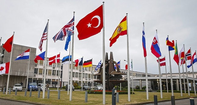 Flags of NATO member countries fly in front of its headquarters in Brussels, Belgium, July 28, 2015.