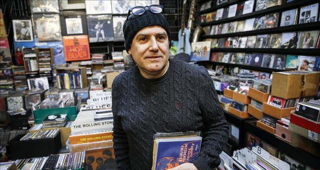 Süleyman Özyıldırım holds David Bowie's Space Oddity record at his shop, Shades in Ankara's Çankaya district that sells cassettes, CDs and vinyl LPs, many of which are relatively hard to find, on Feb. 2, 2019.