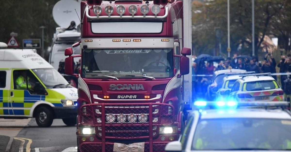 Police officers drive away a lorry in which 39 dead bodies were discovered sparking a murder investigation at Waterglade Industrial Park in Grays, east of London, Oct. 23, 2019. (AFP Photo)