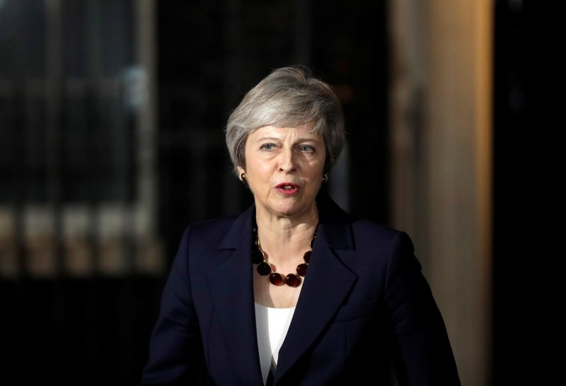 Britain's Prime Minister Theresa May delivers a speech outside 10 Downing Street in London, Wednesday, Nov. 14, 2018. British Prime Minister Theresa May says Cabinet agrees draft Brexit deal with European Union after 'impassioned' debate. (AP Photo)