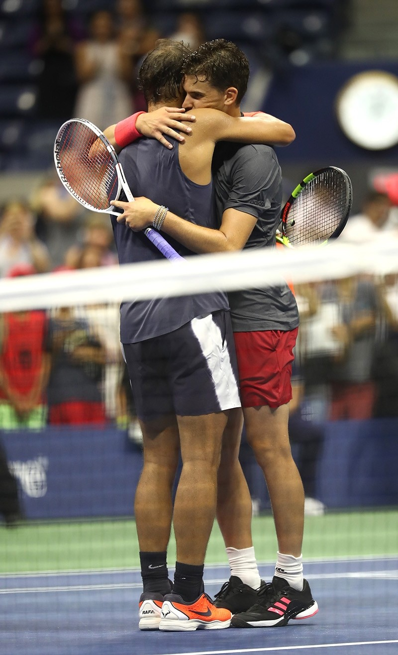 Rafael Nadal of Spain hugs Dominic Thiem of Austria after their men's singles quarter-final match on Day Nine of the 2018 US Open at the USTA Billie Jean King National Tennis Center on Sept. 4, 2018 in New York City. (AFP Photo)