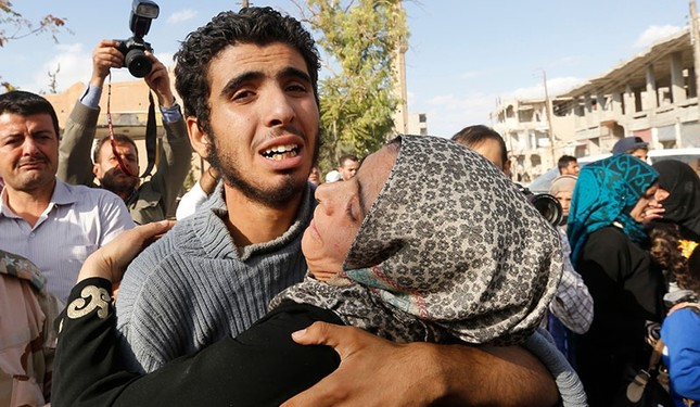 A Syrian man recently released from Daesh group detention is greeted by relatives on October 29, 2017. (AFP Photo)