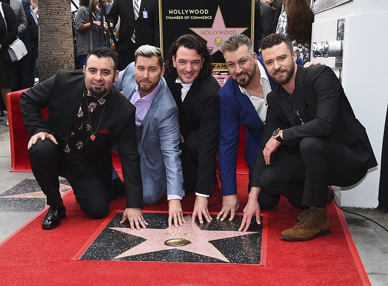 Chris Kirkpatrick, from left, Lance Bass, JC Chasez, Joey Fatone and Justin Timberlake of the band NSYNC appear at a ceremony honoring them with a star on the Hollywood Walk of Fame on April 30, 2018, in Los Angeles. (AP Photo)