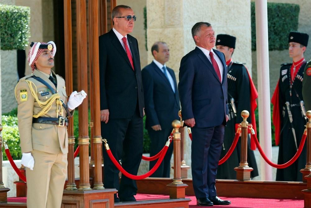 President Erdou011fan (L) and Jordan's King Abdullah II (R) review Bedouin honor guards at the Royal Palace in Amman, Jordan, Aug. 21.