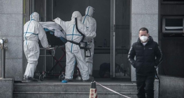 Medical staff members carry a patient into the Jinyintan hospital, where patients infected by a mysterious SARS-like virus are being treated, Wuhan, Jan. 18, 2020. AFP Photo