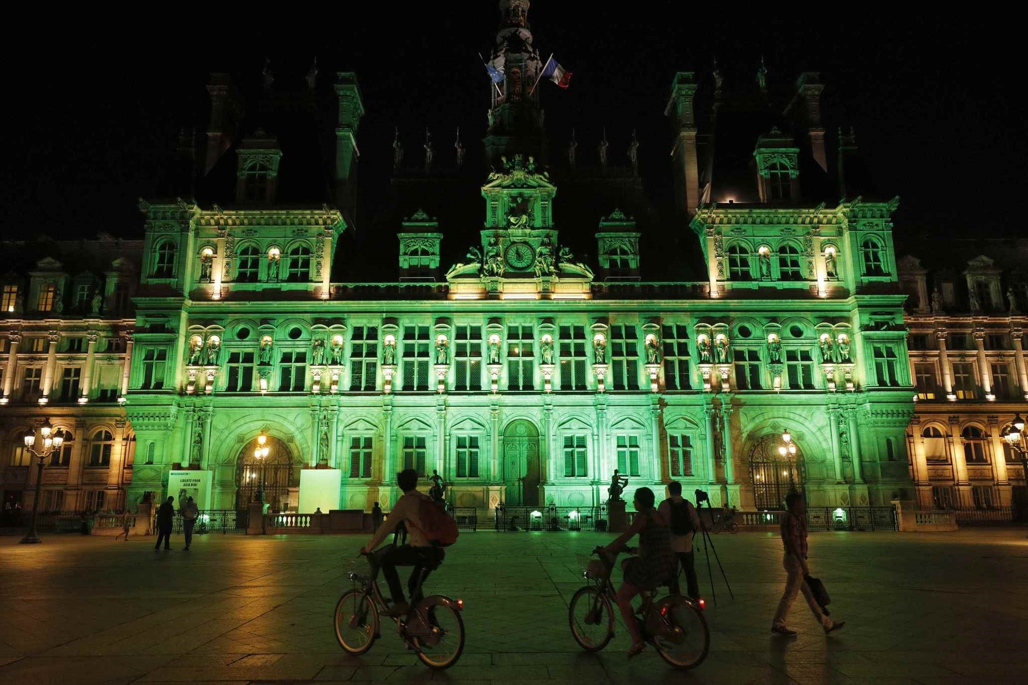 Green lights are projected onto the facade of the Hotel de Ville in Paris, France, after U.S. President Donald Trumpu2019s. (REUTERS Photo)