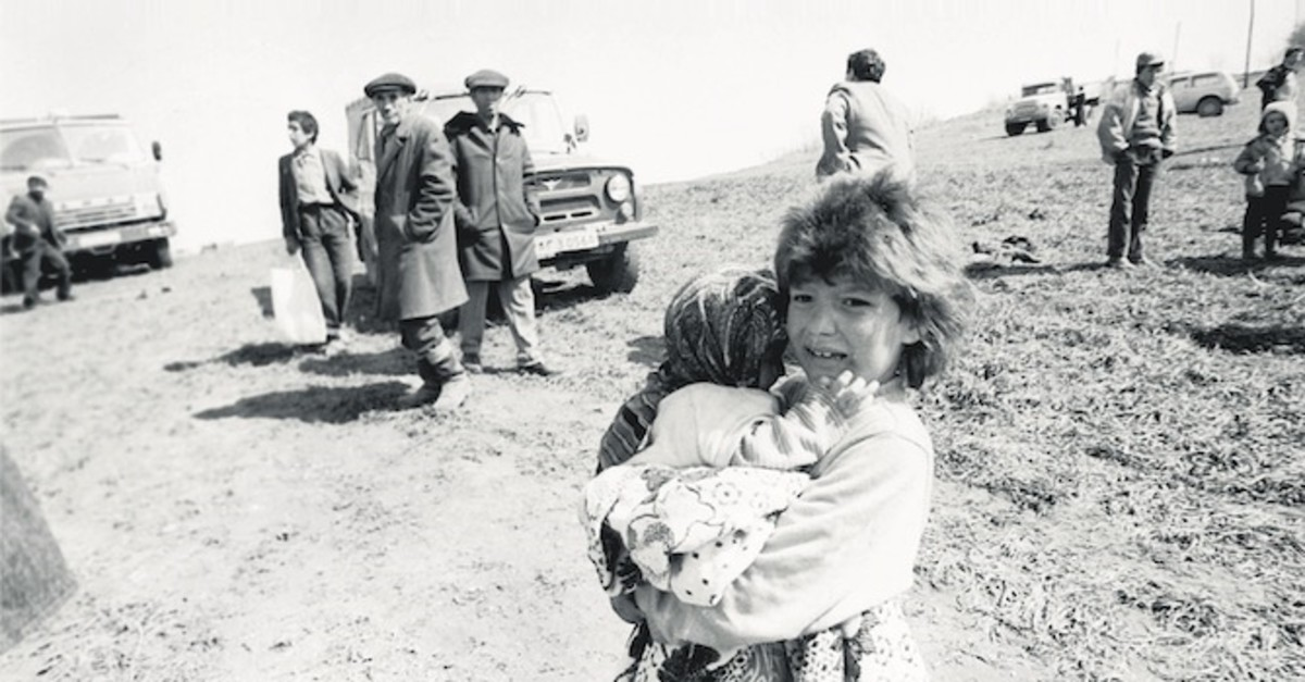 An archive photo provided by Anadolu Agency depicting a girl holding her sister after fleeing the massacre of ethnic Azerbaijanis by Armenians in the town of Khojaly, February 1992.