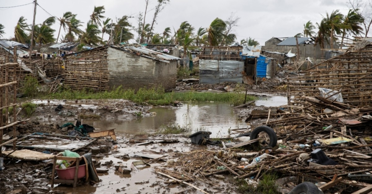 Flood water covers the ground  between rubble where there once use to be houses at an informal settlement in Beira, the fourth largest city in Mozambique, on March 23, 2019. (AFP Photo)