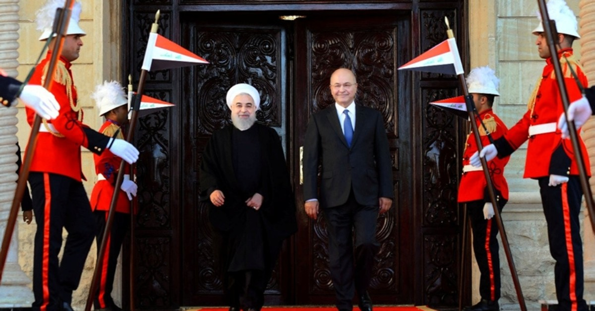 Iraq's President Barham Salih walks with Iranian President Hassan Rouhani during a welcome ceremony at Salam Palace in Baghdad, Iraq, March 11, 2019 (Reuters Photo)