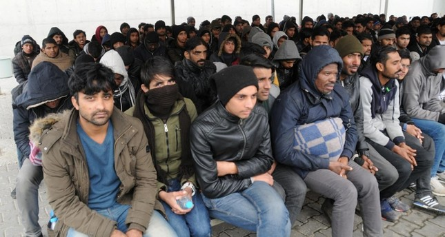 This file photo dated Dec. 05, 2018 shows migrants pushed back to Turkey by Greek officials waiting at an internment center in Meriç district of northwestern Turkey's Edirne province. (DHA Photo)