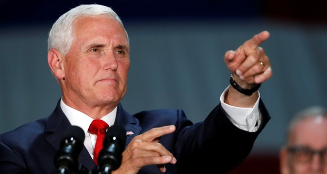 U.S. Vice President Mike Pence points to an audience member as he speaks during a visit to Nellis Air Force Base in Las Vegas, Friday, Sept. 7, 2018. (AP Photo)