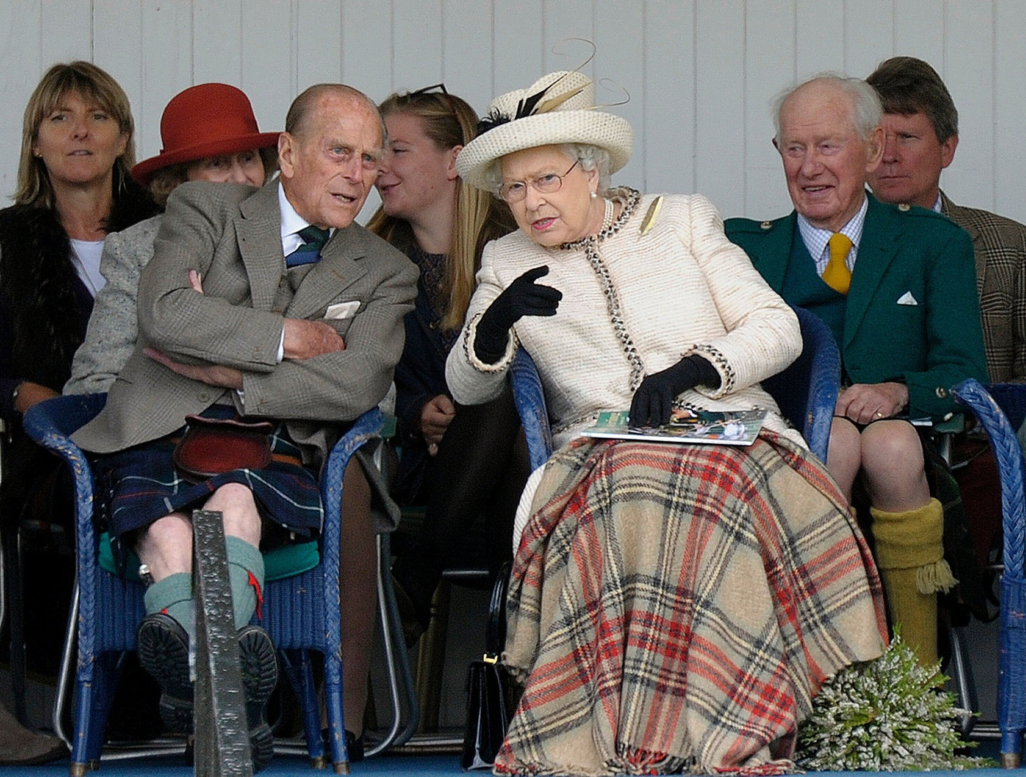 This file photo taken on September 06, 2014 shows Britain's Queen Elizabeth II and her husband Prince Philip (L) attending the Braemar Gathering in Braemar, central Scotland. (AFP Photo)