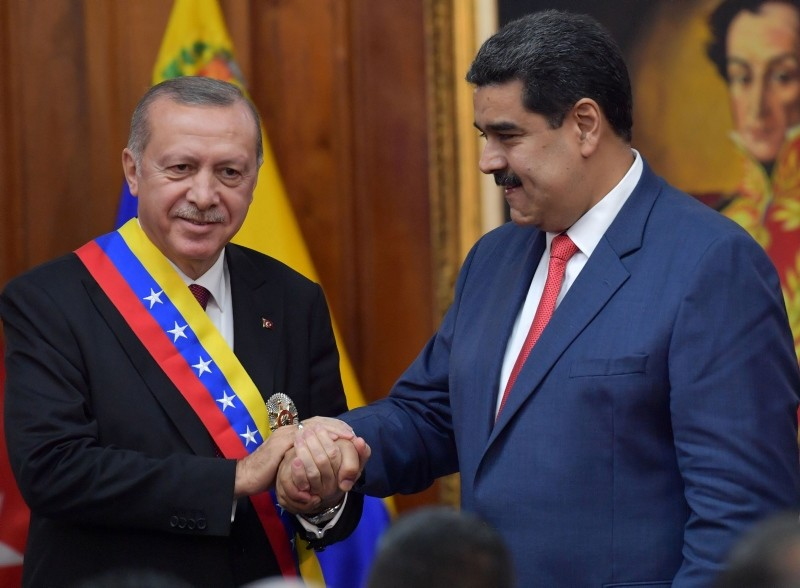 Venezuelan President Nicolas Maduro (R) and Turkish President Recep Tayyip Erdogan are pictured at Miraflores Presidential Palace in Caracas, on December 3, 2018. (AFP Photo)