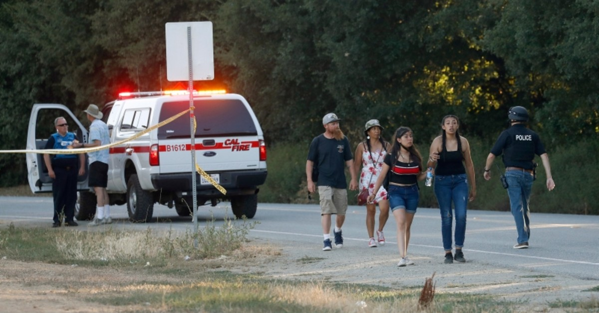 People leave the Gilroy Garlic Festival following a deadly shooting in Gilroy, California. (AP Photo)