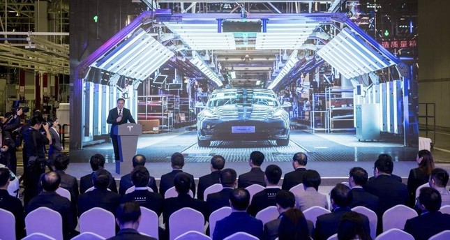 In this photo released by China's Xinhua News Agency, Tesla CEO Elon Musk speaks at a delivery ceremony for the first Tesla Model 3 cars made at Tesla's Shanghai factory in Shanghai, Tuesday, Jan. 7, 2020. Ding Ting/Xinhua via AP