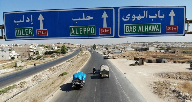 Syrian civilians flee on August 21, 2019 a conflict zone in Syria's rebel-held northwestern region of Idlib, where regime bombardment has killed hundreds since late April. (AFP Photo)