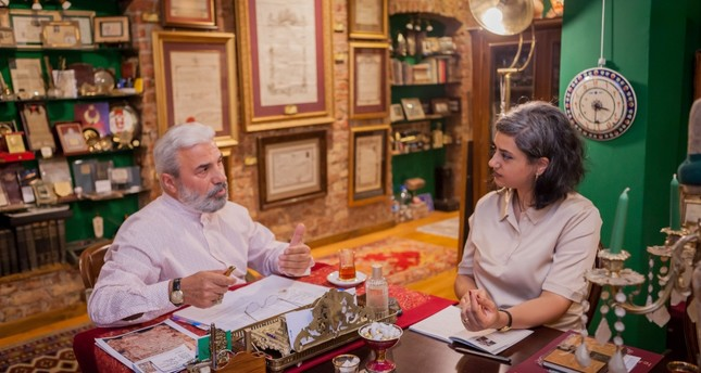 Daily Sabah Culture and Arts editor Zeynep Esra İstanbullu and collector Enver Beşinci having a conversation on the history of ijazah licences.
