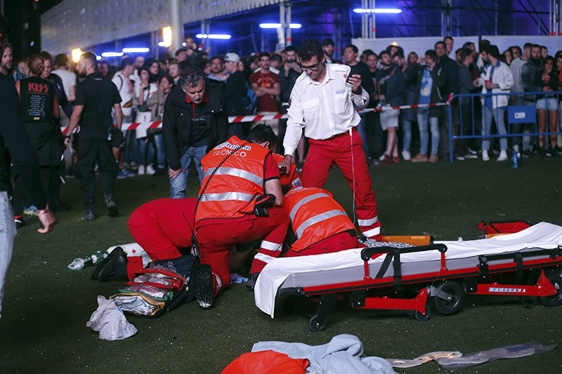 Emergency services assist an injured acrobat who was reportedly injured while participating in an entertainment show in between the concerts of Alt-J and Green Day during the Mad Cool Festival in Madrid, Spain, July 07, 2017. (EPA Photo)