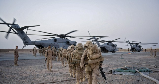 US Marines walk towards the helicopter as part of Operation Khanjar at Camp Dwyer in Helmand Province in Afghanistan on July 2, 2009. AFP