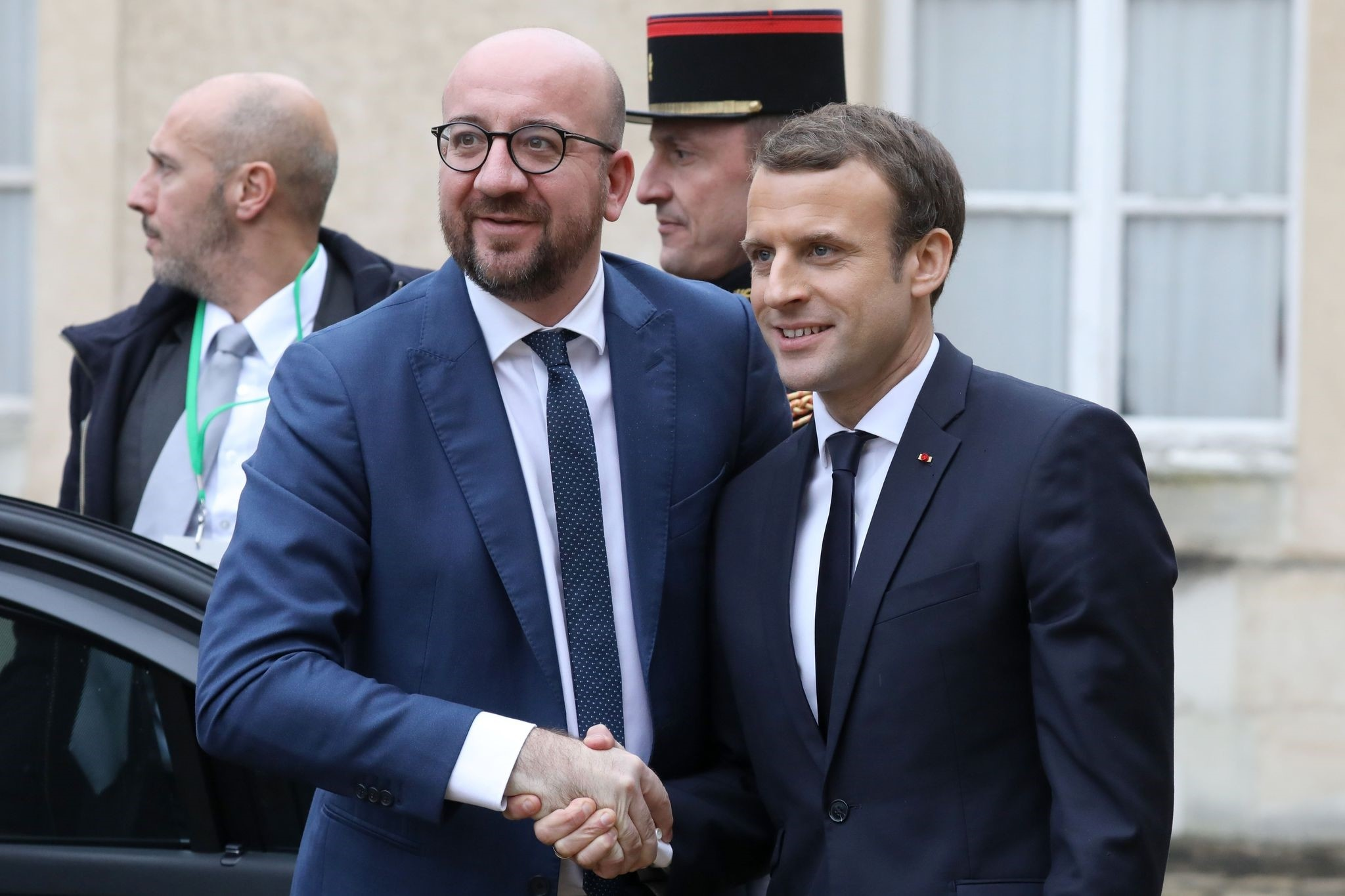 Belgian prime minister Louis Michel (L) is welcomed by French President Emmanuel Macron upon at his arrival for a summit from the underfunded G5 Sahel anti-terror coalition on December 13, 2017. (AFP Photo)