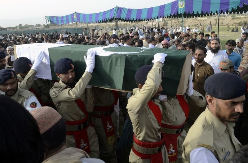 Pakistani troops carry the casket, wrapped in national flag, of provincial candidate Siraj Raisani, who was killed in the Fridayu2019s suicide bombing in Mastung, during a funeral prayer in Quetta, Pakistan, Saturday, July 14, 2018. (AP Photo)