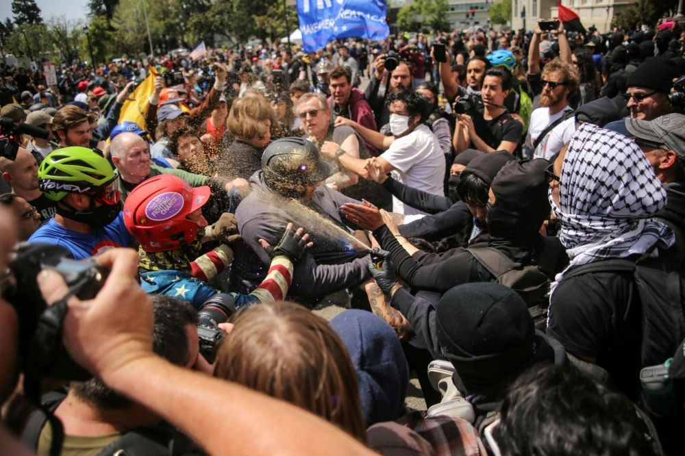 Trump rally members and Antifa protestors clash on the streets of Berkeley, California, April 15