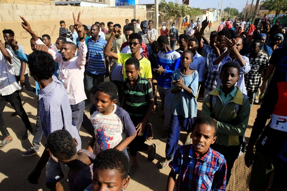 Sudanese demonstrators march as they participate in anti-government protests, Khartoum, Jan. 24, 2019.