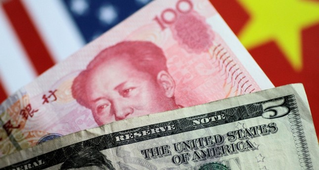 U.S. Dollar and China Yuan notes are seen in this picture illustration June 2, 2017. (REUTERS Photo)