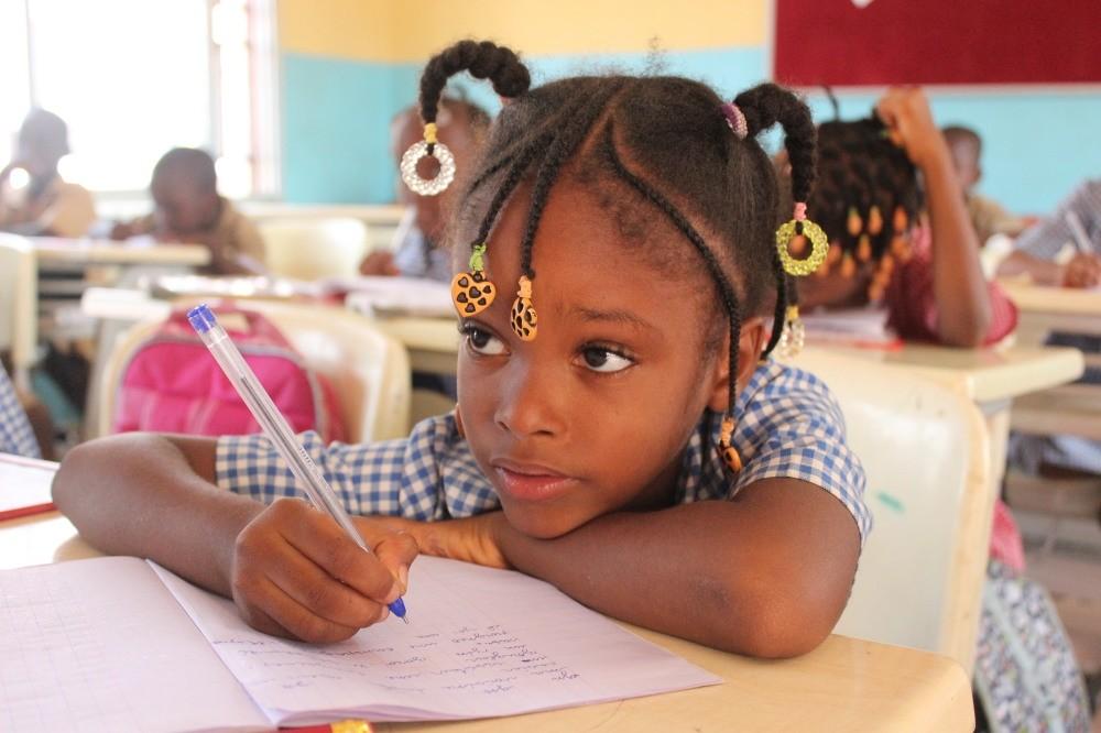 A girl receiving education at a Maarif school in Guinea.
