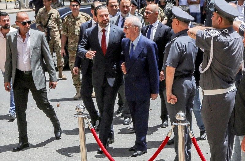 Lebanese Prime Minister Saad Hariri (C-L) with Lebanese member of the parliament Michel El-Murr (C-R) arrive to attend the first session in the parliament in downtown Beirut, Lebanon, 23 May 2018. (EPA Photo)