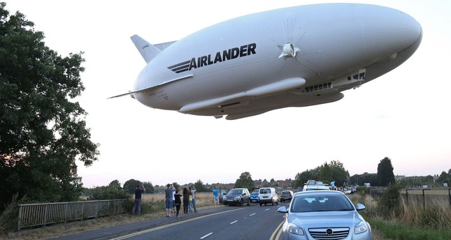 his file photo taken on August 17, 2016 shows the Hybrid Air Vehicles HAV 304 Airlander 10 hybrid airship in the air over a road on its maiden flight from Cardington Airfield. (AFP Photo)