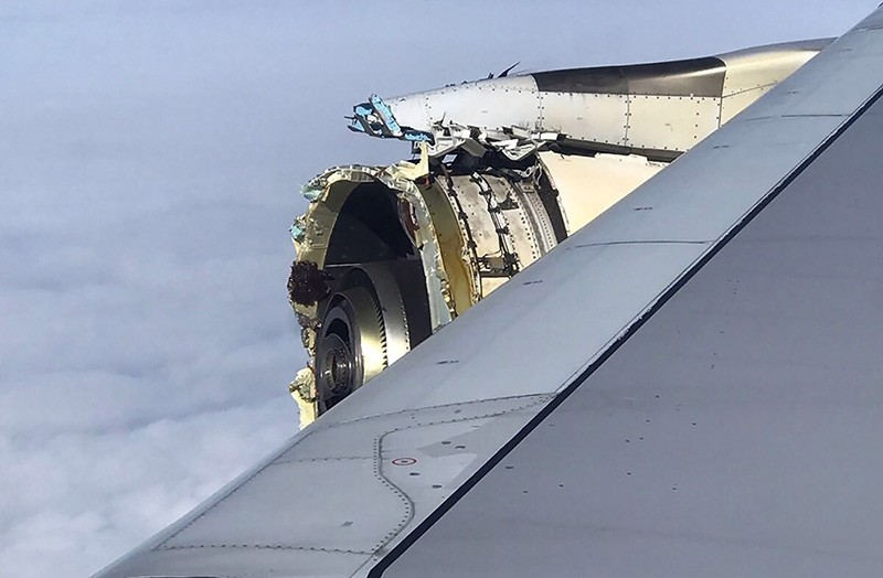 This photo obtained on the twitter account of @Bdaddy1391 and taken on  September 30, 2017 shows the damaged engine of an Air France A380 superjumbo while onboard before it made an emergency landing in Canada. (AFP Photo)