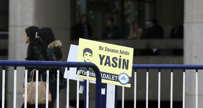 A placard reading Yasin Börü is the name for a cause - #JusticeForYasin is left near the Ankara court where the trial is held AA Photo