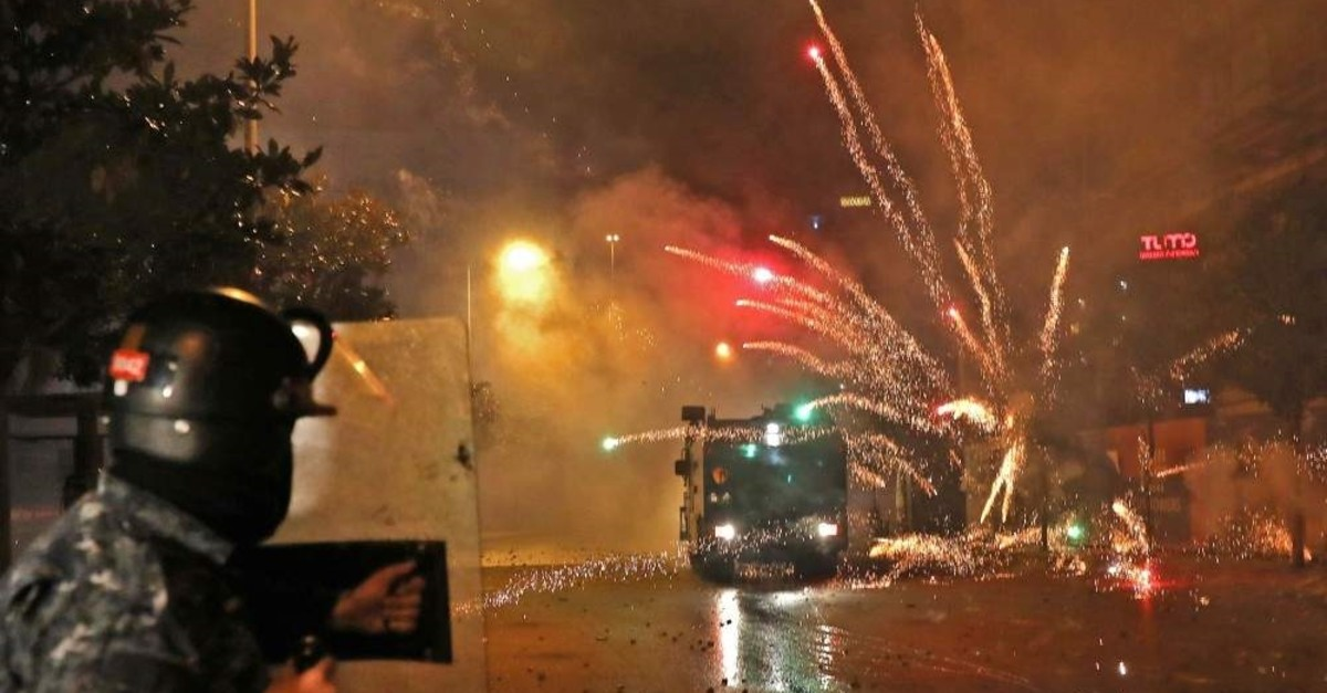 Supporters of Lebanon's Shiite Hezbollah and Amal groups hurl fireworks at security forces, Beirut, Dec. 17, 2019. (AFP Photo)