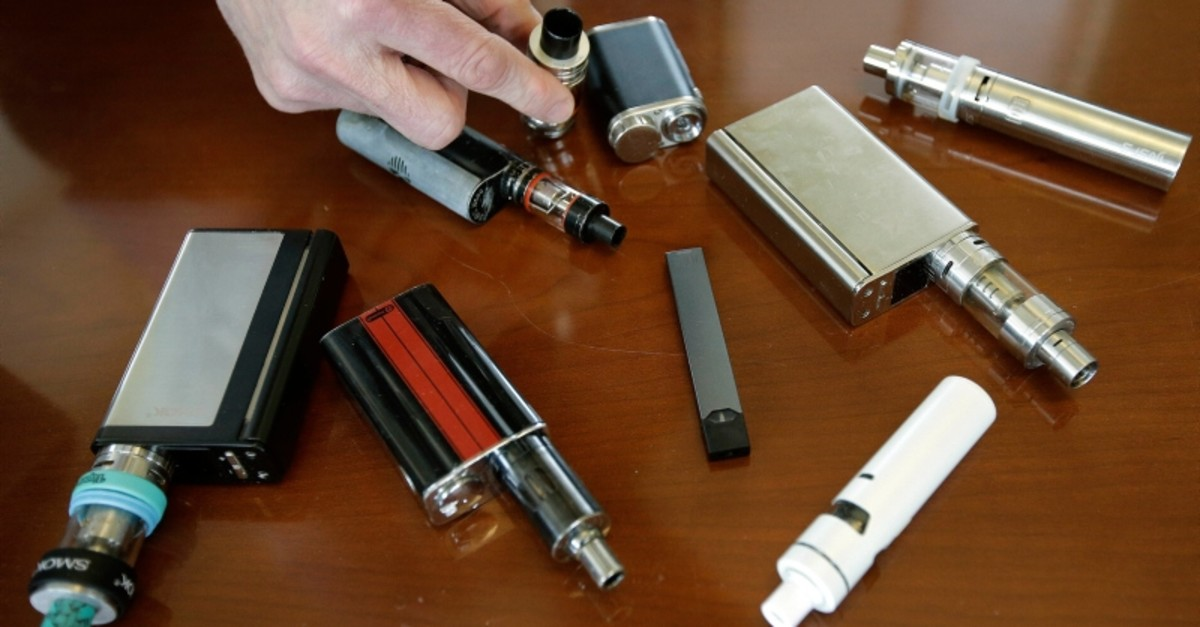 In this Tuesday, April 10, 2018 photo, Marshfield High School Principal Robert Keuther displays vaping devices that were confiscated from students in such places as restrooms or hallways at the school in Marshfield, Mass (AP Photo)