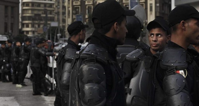 This file photo shows Egyptian security forces closing off a street near the Press Syndicate as journalists protest in Cairo, Egypt, May 3, 2016. AP Photo