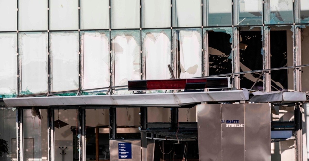 View of damage to the entrance at the front of the Danish Tax Authority at Oesterbro in Copenhagen, Denmark, on August 7, 2019 (AFP Photo)