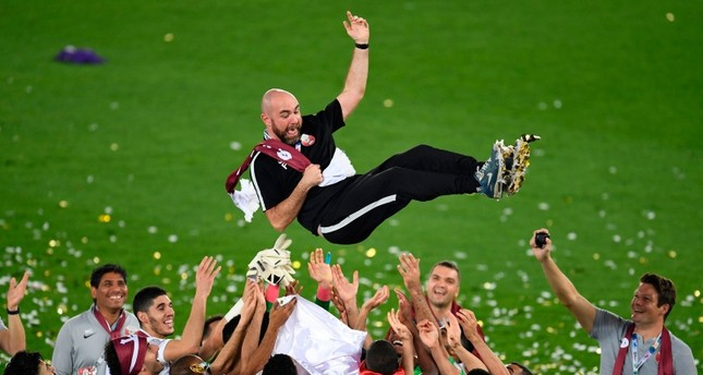 Qatar's coach Felix Sanchez is thrown in the air as his team celebrates their win in the 2019 AFC Asian Cup final football match (AFP Photo)