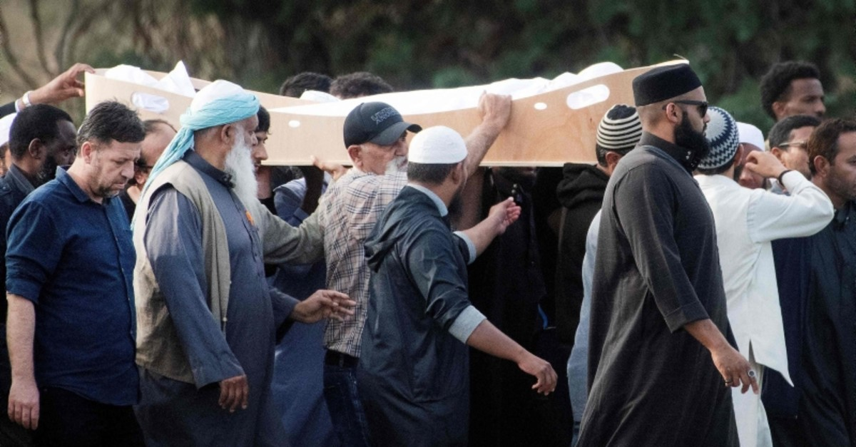 Mourners carry the body of a victim of the Friday March 15 mosque shootings for a burial at the Memorial Park Cemetery in Christchurch, New Zealand, Wednesday, March 20, 2019. (AFP Photo)
